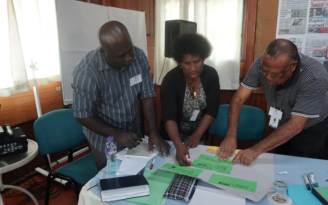 Photo of principals discussing during the In-PNG Scholarships Leadership Conference