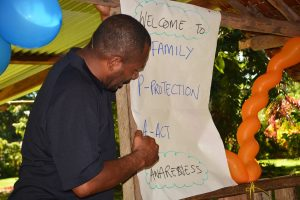 This image demonstrates the work that Melkie Anton does as a male advocate for ending violence against women