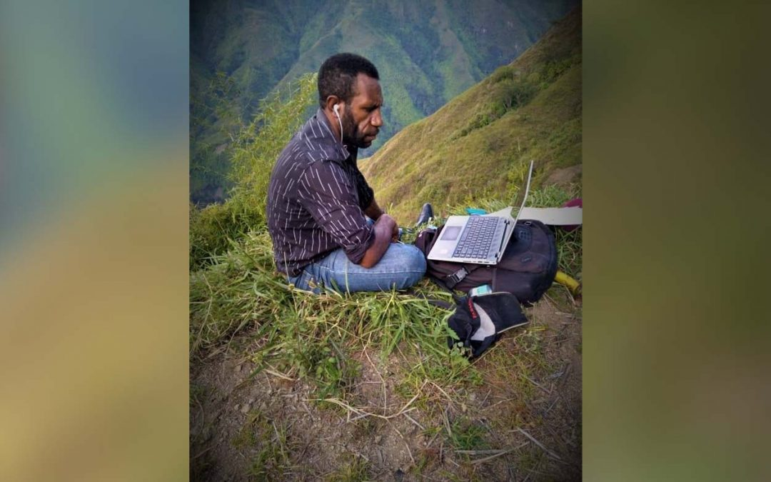 STEM teacher Raphael Ulka accessing internet atop a mountain to participate in the STEM course